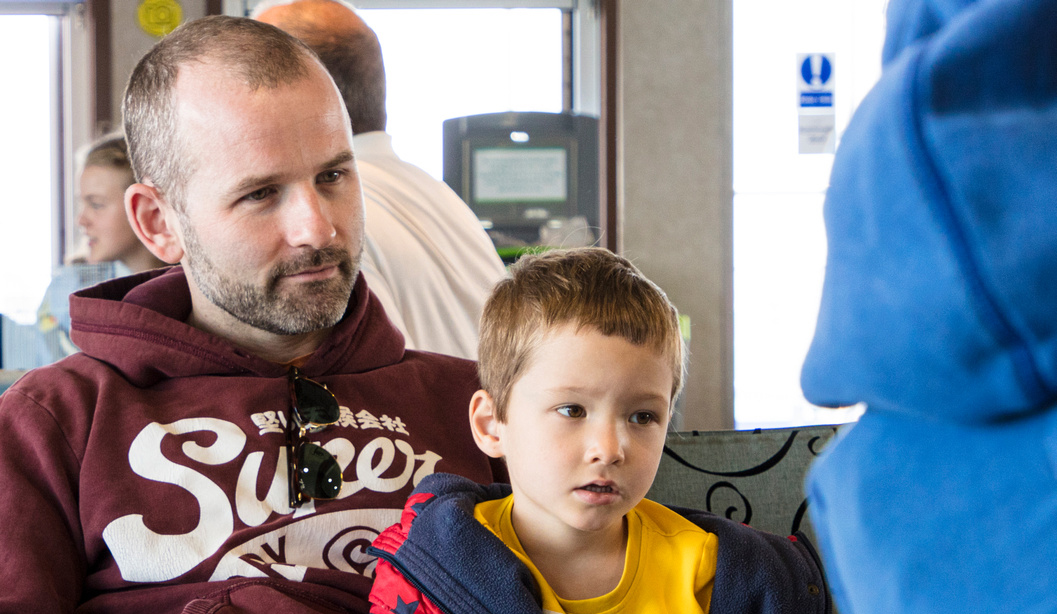 Parent and child sit aboard a Wightlink ferry