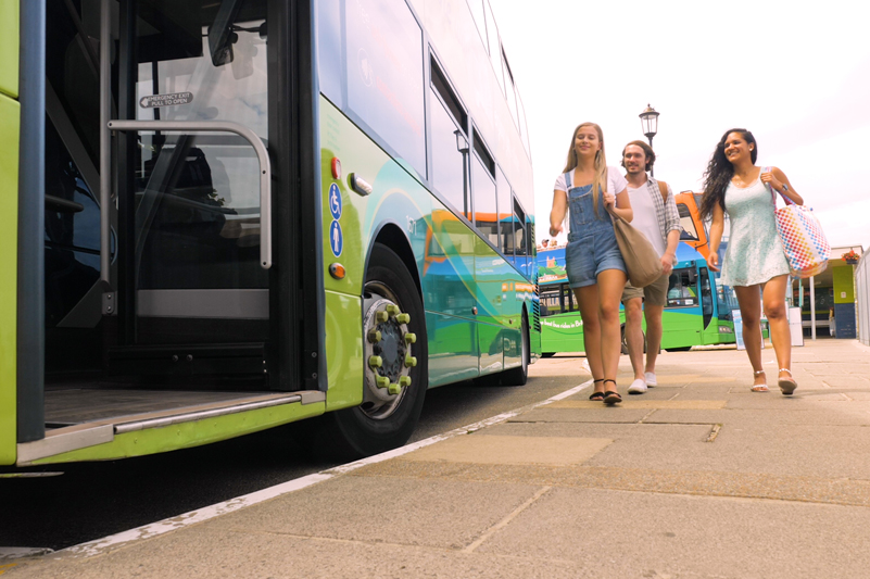 Three people board a Southern Vectis bus