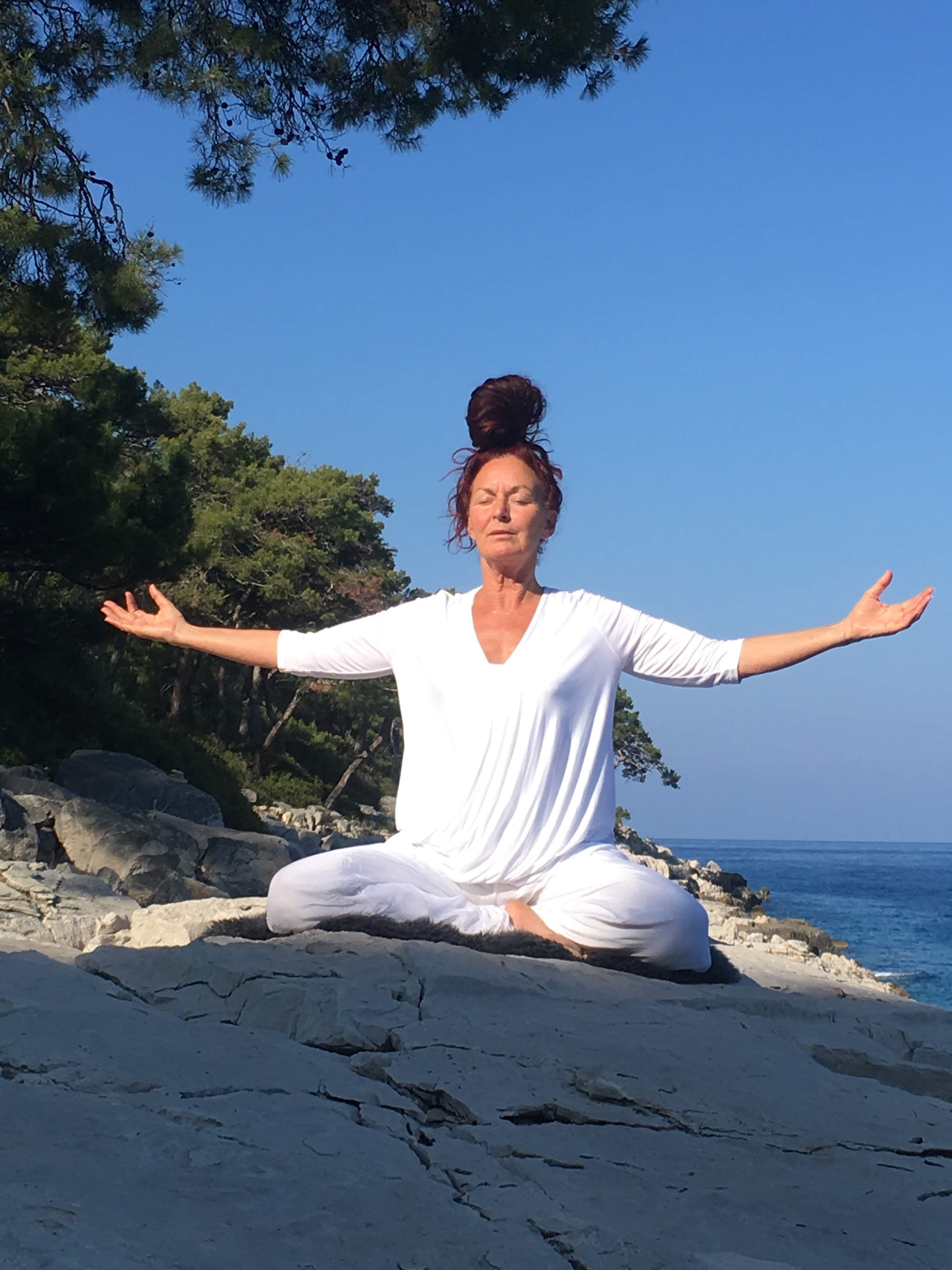 Yoga teacher Carol Macartney practicing Yoga on the Isle of Wight
