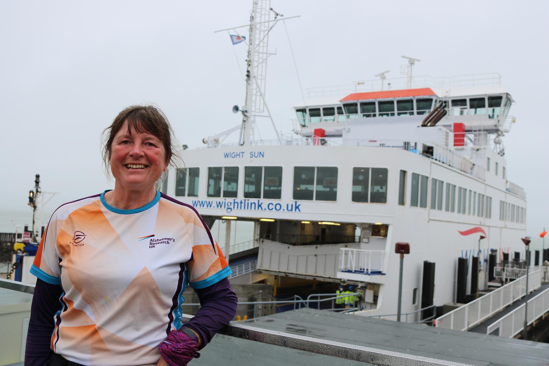 Walker Karen Penny in front of a Wightlink ferry inYarmouth